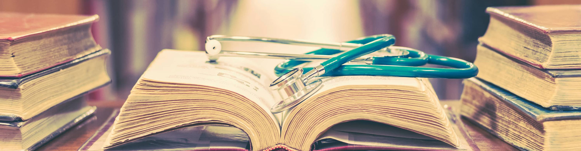 stethoscope on top of a book